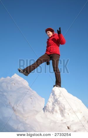 Woman Steps From One Snowy Chunk To Another