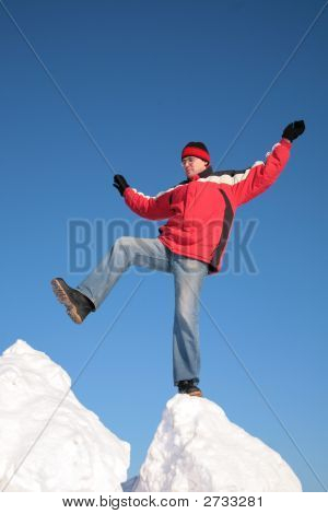 Man Steps From One Snowy Chunk To Another