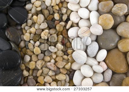 Different kind, color, shape, and size of pebbles