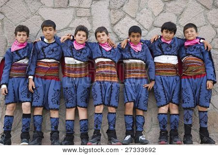A group of school boys with their traditional Turkish Folk costumes