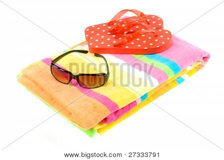 Colorful summer beachwear (flip flops), towel, and sunglasses