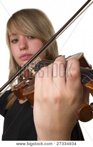 A beautiful teenager playing her violin