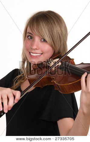 A beautiful happy teenager playing her violin