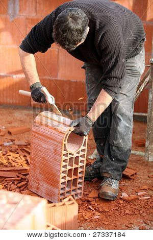 Man shaping a brick