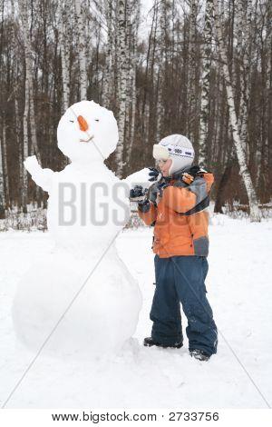 Boy Makes Snowman