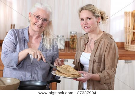 Women making crepes