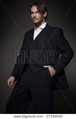Handsome man wearing dark suit