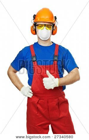 Portrait of young builder in protective safety equipment goggles hard hat earmuffs and respirator gas mask isolated