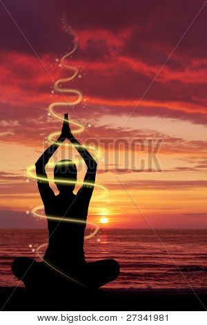 Woman doing yoga exercise at the beach, energetic light and glow effect.