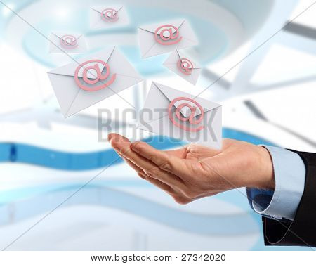 Business hand with email messages flying, concept of future technology in delivery of letters.