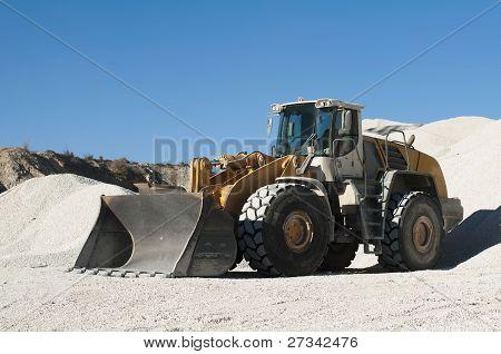 Excavator In A Limestone Quarry