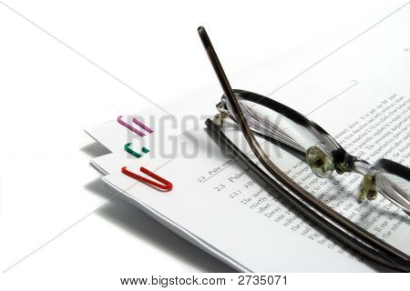 Glasses On Scientfic Paper Isolated On White