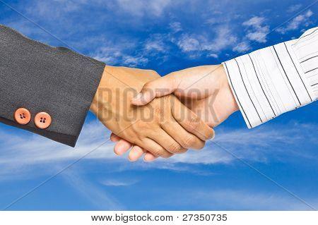 Business Handshake On Sky Background