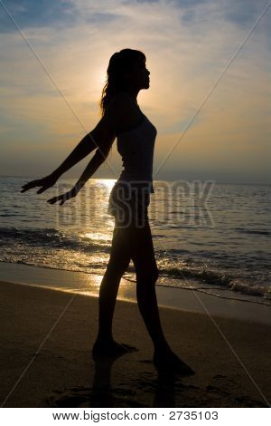 Woman Relax By The Sunset Beach