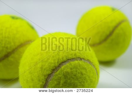 Tennis Balls On Gray With Shadows