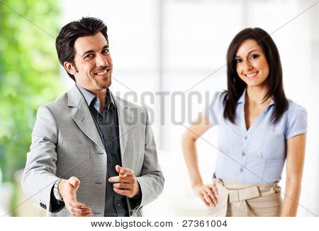 Portrait of an handsome businessman introducing himself
