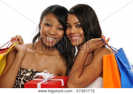 Beautiful African American Teens holding shopping bags smiling isolated on a white background