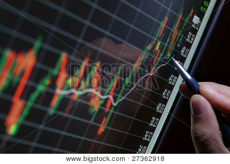 pen showing financial chart on screen