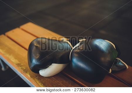 Two Black Boxing Gloves Lie