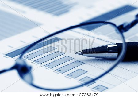 Pen,Glasses and Financial Graph