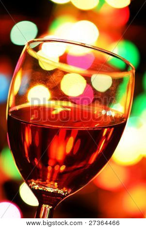 Close up on Glass of Red Wine with Colorful Lights.