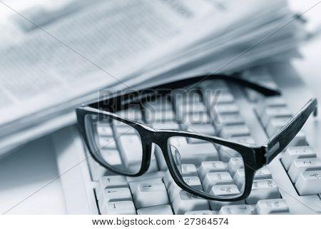 glasses on computer keyboard