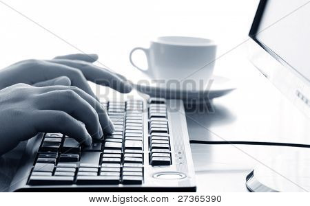 Office life--Businessman typing on a computer keyboard