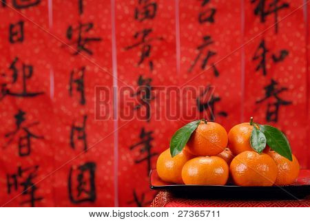 Pile of orange with spring festival couplets background,