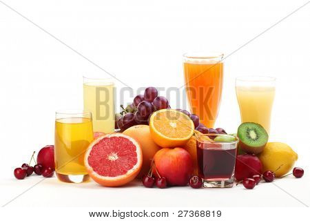 Glasses of fruit juice with fruits on white background.