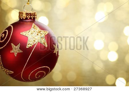 Christmas ball on abstract golden light background,Shallow Dof.