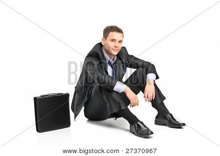 A disappointed businessman and his briefcase isolated on white background