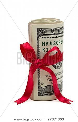 A wad of US one hundred dollar bills wrapped in a red ribbon with a gift bow attached.
