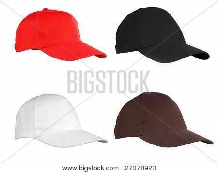 Four Caps Isolated On White. Red, Black, White And Brown.