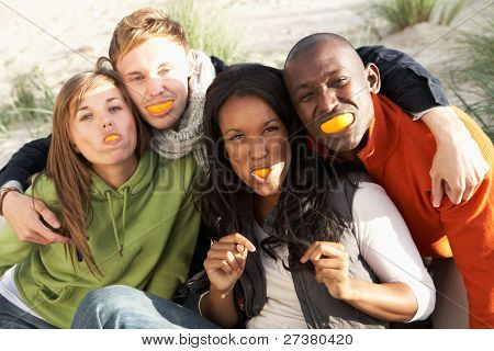 Group Of Friends Pulling Funny Faces On Beach