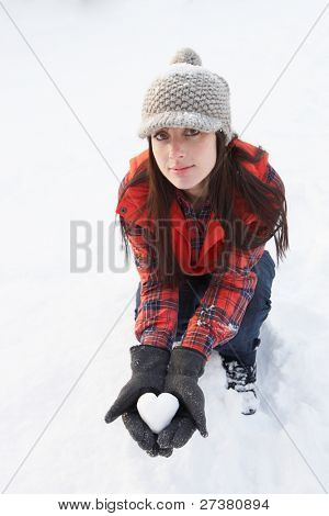 Woman Holding Heart Made Out Of Snow