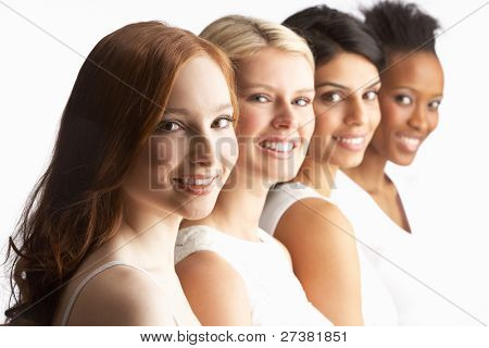 Portrait Of Four Attractive Young Women In Studio Standing In Line