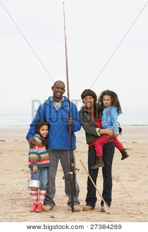 Family On Beach Fishing Trip