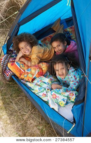 Children Having Fun Inside Tent On Camping Holiday