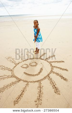 Girl drawing in sand