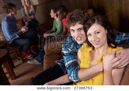 Young happy  couple in cafe