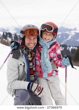 Young Father And Daughter On Ski Vacation