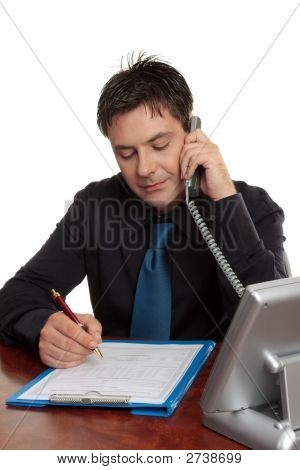 Businessman Or Doctor Filling Out Form