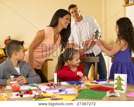 Hispanic family making Christmas cards