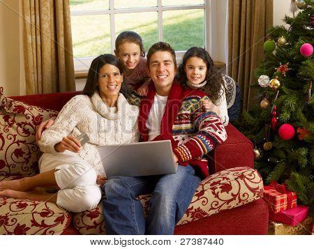 Hispanic family Christmas shopping online