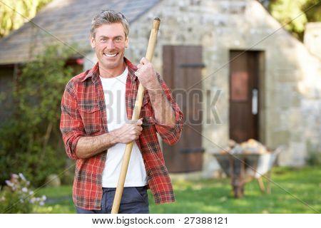 Man working in country garden