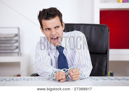 Businessman slave trapped with chains at his own office