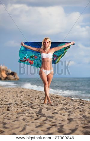 Beautiful Woman Enjoying The Breeze By The Sea