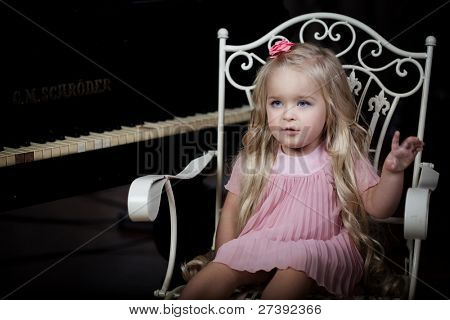Image of a little girl in a fashionable luxury interior