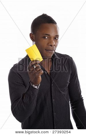 Young Black Man With Yellow Card In His Hands
