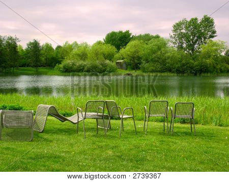 Chairs In Park Overlooking The Lake
